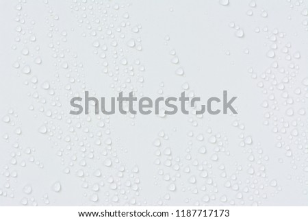 Close up water drops on white tone background. Abstarct ultramarine wet texture with bubbles on window glass surface. Raindrop, Realistic pure water droplets condensed for creative banner design #1187717173