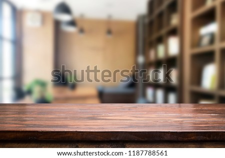 Wooden board empty Table Top And Blur Interior over blur in coffee shop Background, Mock up for display of product. #1187788561