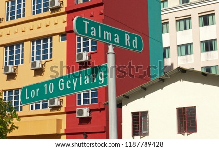 singapore, singapore - november 29, 2009: view onto facades of buildings in geylang and street sign #1187789428