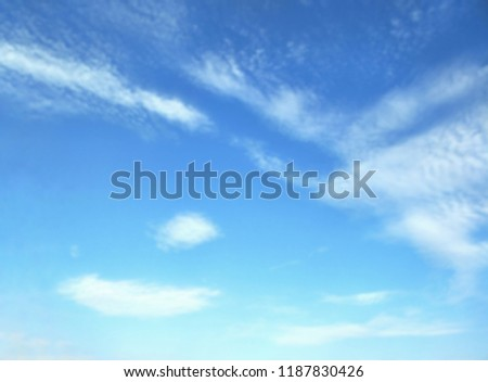 Blur image of clouds and blue sky for natural  background design in brightly and refreshing concept,low angle view with copy space  #1187830426