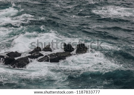 dramatic shot of ocean waves crashing on rocks for background #1187833777
