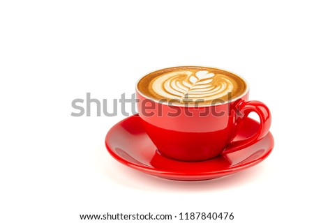 Side view of hot latte coffee with latte art in a bright red cup and saucer isolated on white background with clipping path inside. #1187840476