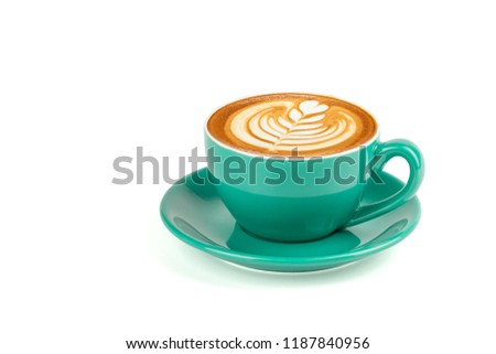 Side view of hot latte coffee with latte art in a green cup and saucer isolated on white background with clipping path inside. #1187840956