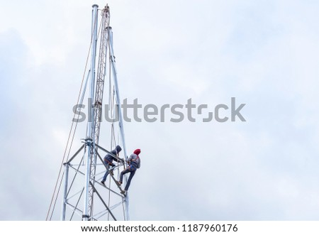 Electricians working in the height for installation antenna communication metal high tower  #1187960176