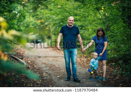 happy family with son on background forest #1187970484