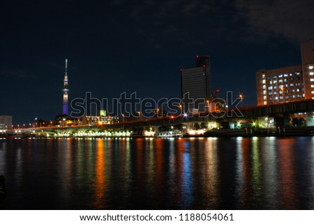 Night-time long exposure of Tokyo Skytree with colourful light reflections in the Sumida River, Tokyo. #1188054061