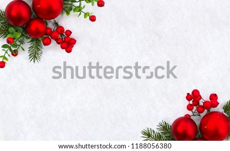 Christmas decoration. Frame of twigs christmas tree, christmas red balls and red berries on snow with space for text. Top view, flat lay #1188056380