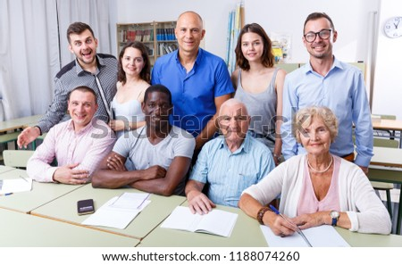 Portrait of group students different ages in modern classroom #1188074260