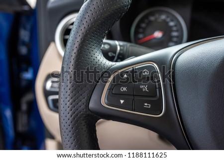 Helm of car, by closeup. Car wheel close up. Steering Wheel #1188111625