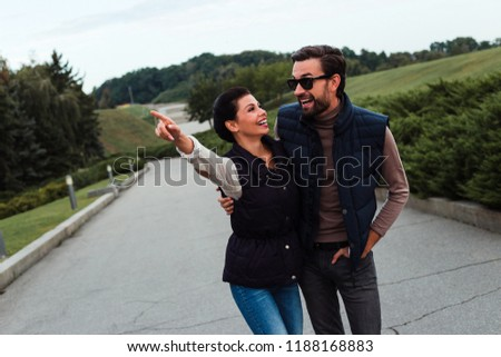 Their first trip together. Young beautiful couple bonding to each other while walking in the park in autumn   #1188168883