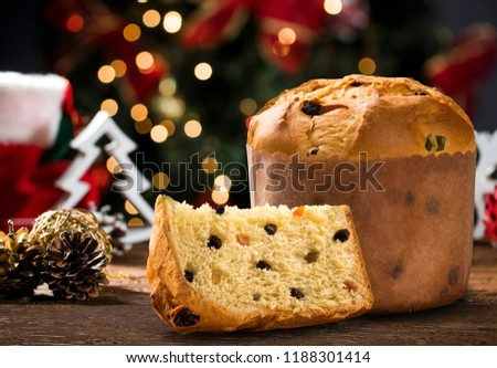 Delicious Panettone slice with candied fruits with blinking blurred christmas lights. #1188301414