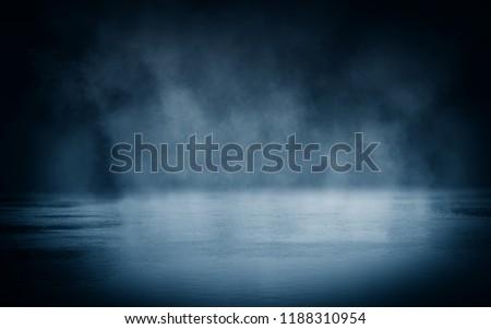 Background of an empty dark room. Empty walls, lights, smoke, glow, rays #1188310954