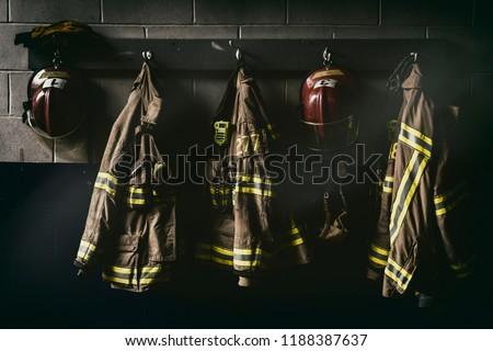 Firefighter hanging suit in a dark room