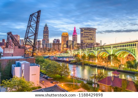 Cleveland, Ohio, USA city skyline over the Cuyahoga River.