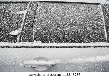 Frozen side window of  car closeup Royalty-Free Stock Photo #118843987