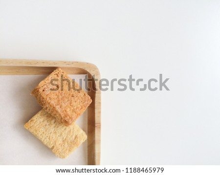 Crispy Bread Butter Sugar on wooden tray on white background. Biscuit homemade. Dessert, Snack. Top view. Soft sunlight. Copy space. #1188465979