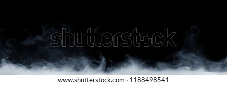 Panoramic view of the abstract fog or smoke move on black background. White cloudiness, mist or smog background.  Royalty-Free Stock Photo #1188498541