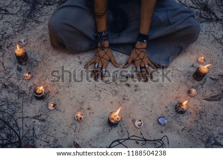 woman with candle deep in forest. Witch craft concept Royalty-Free Stock Photo #1188504238