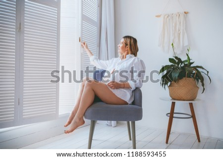 Pregnant mothercare lifestyle concept, blond Bob hairstyle woman health care. white light interior #1188593455