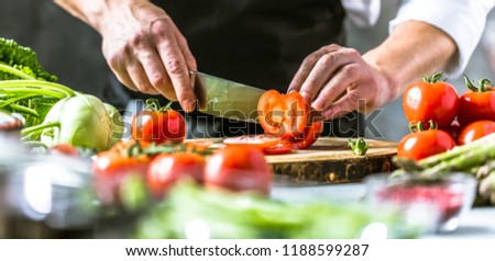 Chef cook preparing vegetables in his kitchen. #1188599287