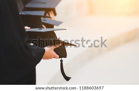 Close up Graduate holding a hat. Concept sucess education in University with copy space. Education graduation in university theme concept. #1188603697