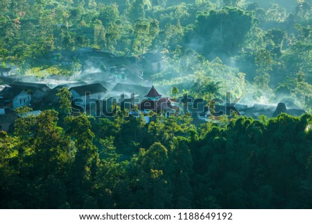 Magelang, Indonesia. February 27, 2018.  Misty morning from the viewing post at ketep magelang, central java, Indonesia, surrounds residents' settlements on the hillside. #1188649192