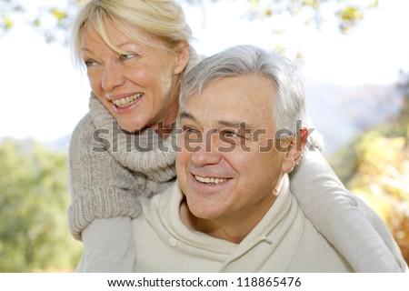 Senior man giving piggyback ride to wife #118865476