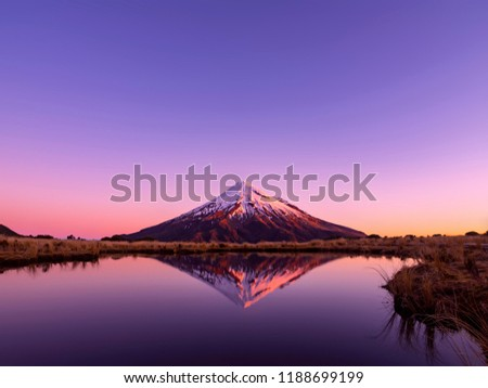 Mt Taranaki Mountain Reflection on the Tarns Lake New Zealand in the Evening with Beautiful Sunset Colours on the Snow #1188699199