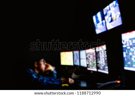 Blurred of man engineer works with the tablet in the production control room.Control room of a steam Turbine,Generators of the coal-fired power plant for monitor process, business and industry concept #1188712990