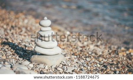 Stones piramide on pebble beach - harmony, meditation, patience and peace of mind concept Royalty-Free Stock Photo #1188724675