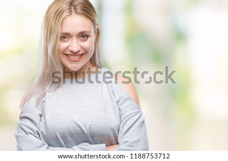 Young blonde woman over isolated background happy face smiling with crossed arms looking at the camera. Positive person. #1188753712