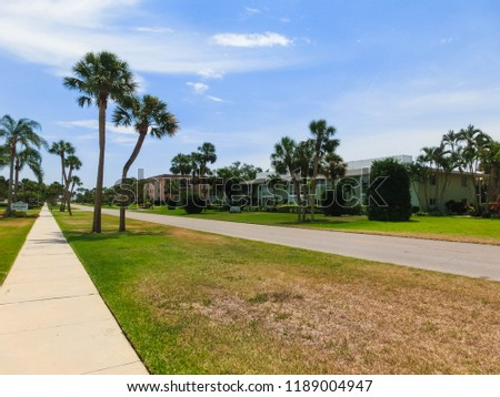 Naples, USA - May 8, 2018: Exterior of a two-story modern resort building at Naples, Florida #1189004947