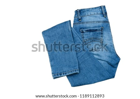 jeans on the background, blue jeans lie on a wooden background, #1189112893