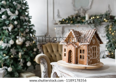 gingerbread house in living room. Christmas morning. Wonderful holiday mood #1189178356