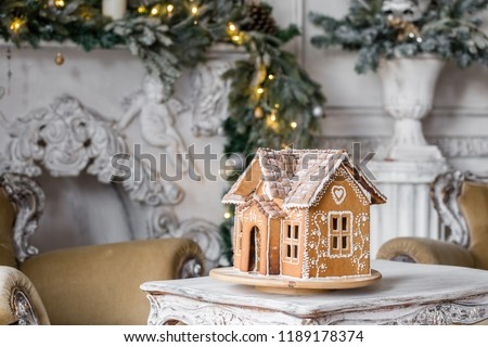 gingerbread house in living room. Christmas morning. Wonderful holiday mood #1189178374
