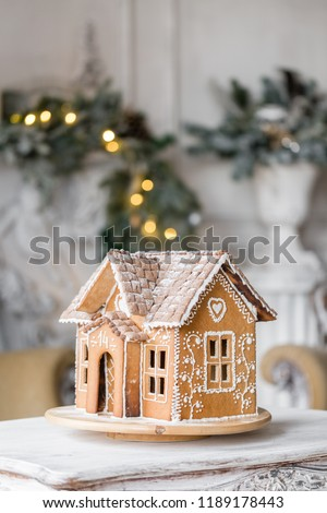 gingerbread house in living room. Christmas morning. Wonderful holiday mood #1189178443
