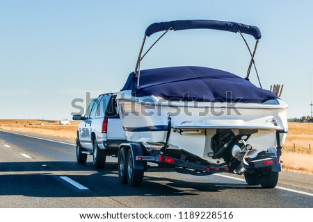 Truck towing a  boat on the interstate, California #1189228516