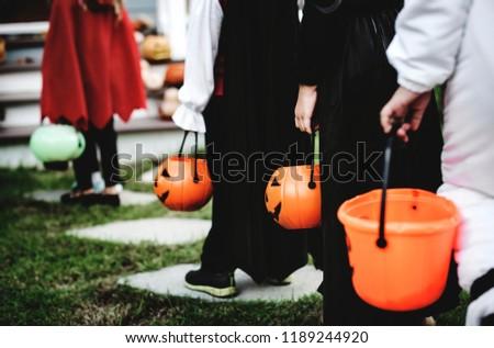Little children in Halloween costumes #1189244920