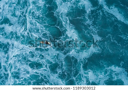 Aerial view of a surfer in the Atlantic Ocean #1189303012