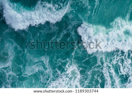 Aerial view of a breaking wave in the Atlantic Ocean Royalty-Free Stock Photo #1189303744