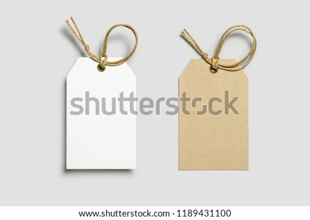 Blank tag tied for hang on product for show price or discount isolate on white background with clipping path. Price tags,Cardboard labels isolated on white. #1189431100