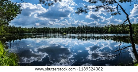 Lake Panorama in national park near Helsinki, Finnland during the summer, clouds reflection #1189524382