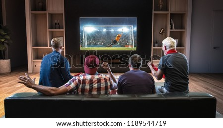 Group of fans are watching a soccer moment on the TV and celebrating a goal, sitting on the couch in the living room. The living room is made in 3D. #1189544719