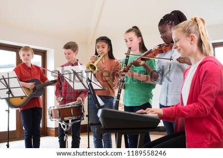 High School Students Playing In School Orchestra Together #1189558246