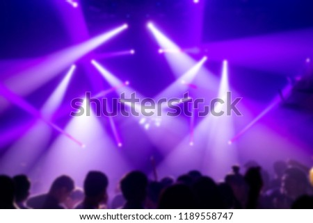 Effects blur Concert, disco dj party. People with hands up having fun  #1189558747