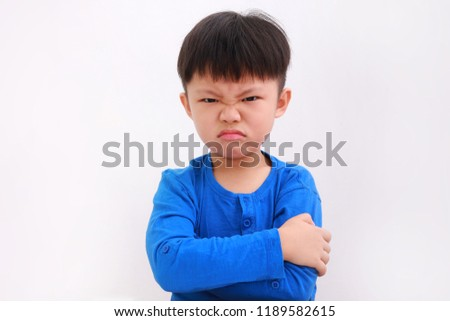 Angry little asian boy showing frustration and disagreement, isolated on white background Royalty-Free Stock Photo #1189582615