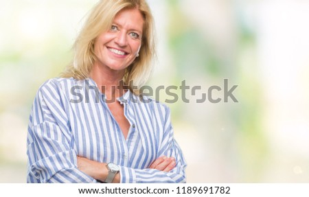 Middle age blonde business woman over isolated background happy face smiling with crossed arms looking at the camera. Positive person. #1189691782
