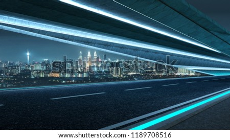 Futuristic style highway road with blue neon light and cityscape background . #1189708516