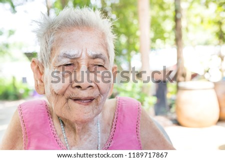 old Asian female on nature background, she feeling happy and smile, elderly happiness, gray hair old female, elderly health promotion #1189717867