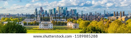 London, England, Panoramic Skyline View Of Greenwich College and Canary Wharf At Golden Hour Sunset With Blue Sky And Clouds  #1189885288